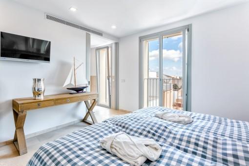 Doble dormitorio con luz natural