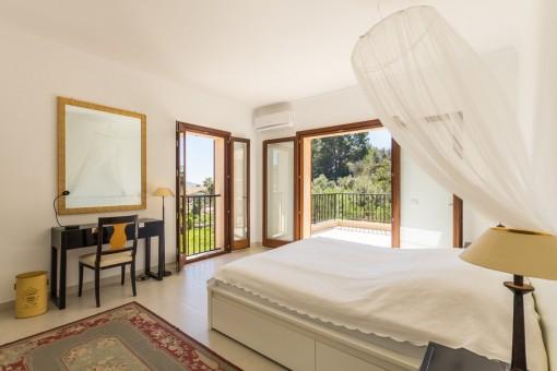 Dormitorio con accesso a la terraza