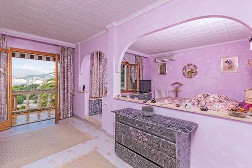 Dormitorio con accesso al balcón