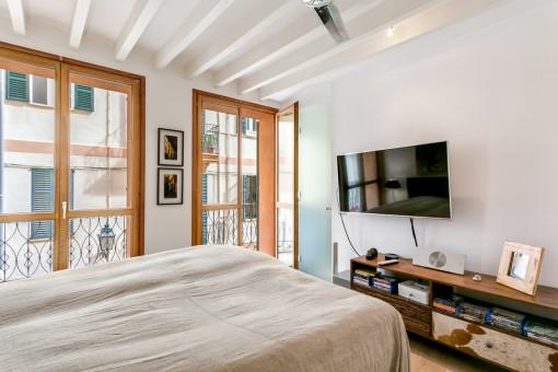 Uno de los dormitorios con baño en suite