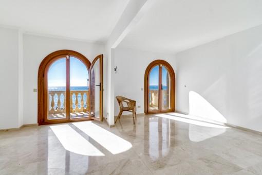 Otra habitación con una terraza pequeña y vistas impresionantes