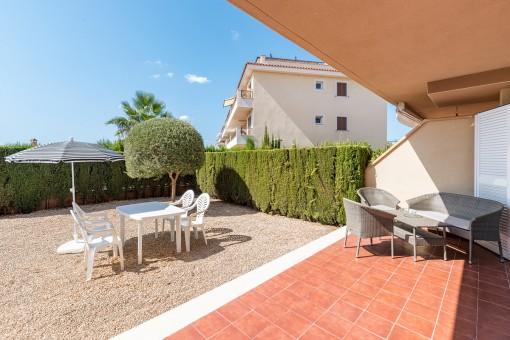Terraza con área de jardín