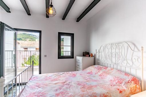 Dormitorio con propria terraza
